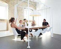 table with swinging chairs