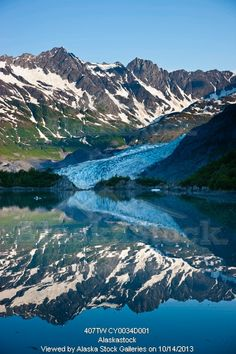 Photo of Shoup Glacier reflected in the water, early morning, Shoup Bay State Marine Park, Prince William Sound, Valdez, Southcentral Alaska...