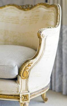 gold and cream antique looking chair (love the print with the cursive writing!)