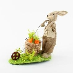 Decorative polyfoam rabbit with synthetic sisal details pinned with Pinvolve - pinvolve.co