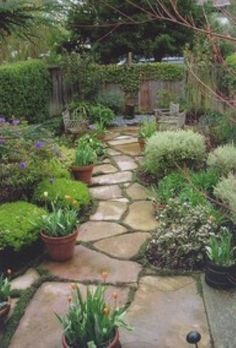 There is a lot of flagstone in my future dream yard :) I love this !