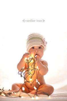 Christmas Lights Baby Photo BAD Idea 1.) Electrocution risk 2.) Burn risk (depending on the type of lights) 3.) chemicals in the lights (lead) 4.) glass can break if they bite down on the lights.  Better to be safe and not sorry. Don't take the risk!!!!!