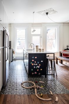 The first floor of this house, built and located in the McGill neighborhood of Montreal, was the perfect spot for a large kitchen and living area, which was missing from the old layout—a makeshift kitchen was previously located on the floor above. Wood Floor Kitchen, Kitchen Tiles, Kitchen Flooring, Flooring Ideas, Vinyl Flooring, Kitchen Cabinets, Kitchen Living, New Kitchen, Home Decor Ideas