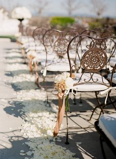 yes to those brown chairs and the rose petal aisle decor