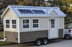 Love the exterior, especially the solar.  The Americana Tiny House On Wheels