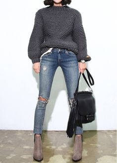 Heavy knits, ripped jeans, suede boots. Via Death By elocution