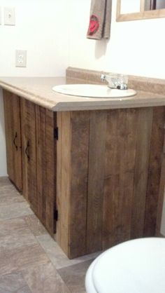 I made this Bathroom vanity made from pallet wood.