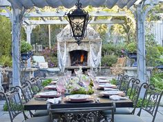 Gray pergola and outdoor fireplace - A stylish and functional outdoor dining room from designer Heather Lenkin. Outdoor Rooms, Outdoor Dining, Outdoor Gardens, Outdoor Life, Outdoor Ideas, Outdoor Stone Fireplaces, Modern Fireplace, Dining Room Inspiration, Interior Exterior