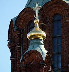 Uspenski Orthodox Cathedral, Helsinki, largest orthodox church in Western Europe. Built in the mid-19th century after a 16th-century church near Moscow. Its 13 onion domes represent Christ and the 12 Apostles.