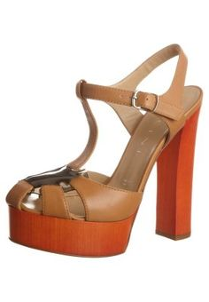 I have a pair that look just like these, but they're wedges!