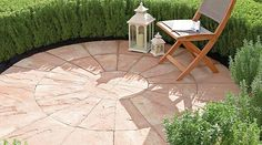 circular paving with mini hedge..all it needs is a weeping willow above..