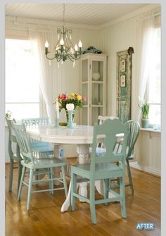 White table with mismatched chairs painted the same color