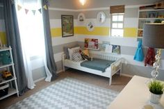 I like the walls with the yellow stripe in the middle, and the oval picture frames for the animal prints! Cute!