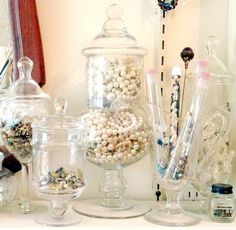 Drop your jewelry into pretty clear glass jars...not only does it look pretty, you can easily find what you need.
