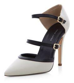 Chaussures pointues à talon en suédine noir et blanc avec brides sur le devant