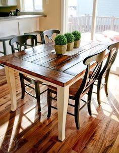 paint dining room table legs antique white and re-stain and varnish the top. then paint chairs black