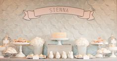 Pretty white dessert table which could be used for a communion