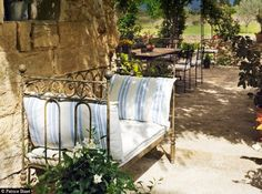 If you can believe it, that's a child's bed frame used as an outdoor settee. French Country Interiors, French Country Farmhouse, Farmhouse Chic, Country Chic, Outdoor Spaces, Outdoor Chairs, Outdoor Living, Indoor Outdoor, Outdoor Decor