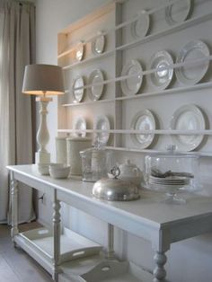 Shallow plate storage for a big, statement wall.  Same idea for use as picture ledges.