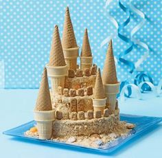 Sandcastle Cake by familyfun: Easy fun with vanilla wafers, jumbo and small ice cream cups, sugar cones and graham crackers. Coolest cake ever! Food Cakes, Cupcake Cakes, Sand Castle Cakes, Sugar Cones, Easy Cake Decorating, Decorating Ideas, Cute Cakes, Creative Cakes, Creative Ideas
