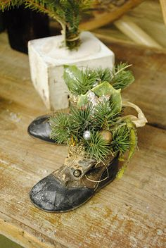 antique baby shoes with christmas greenery...