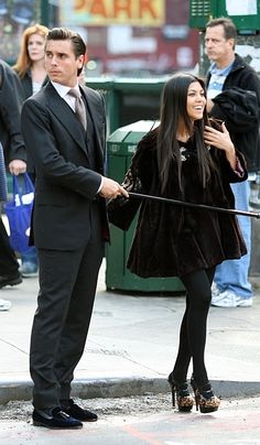 Scott Disick and his walking stick.