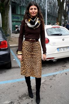 Giovanna - love the combination of leopard skirt + chocolate brown pullover + boots and what looks like an Hermes scarf...