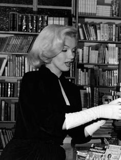 Marilyn photographed by André de Dienes, 1953, in a Los Angeles bookshop.