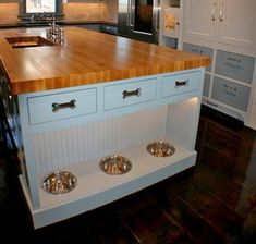 The ceiling +Dogs can dine in style with built-in dog bowls at the base of a kitchen island designed by Artisan Kitchens Inc. in Osterville, Mass. Drawers with dog bone cutouts conceal pet food and treats. Dog Spaces, Animal Room, Dog Rooms, Dream Home Design, Dog Houses, House Dog, Home Projects, Home Kitchens, Kitchen Remodel