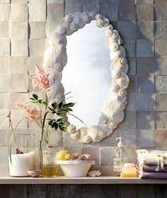 Shell Mirror .. just hot glue different size sand dollars around the edge of a frameless mirror