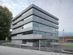 a f a s i a: Lütolf und Scheuner Architekten gevel horizontaal beton compositie luifel inkom kantoor school POLK