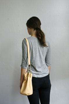 bag // butter $125 CAD natural leather, lined in beige cotton 28cmx26cm, strap 90-120cm BUY NOW ON ETSY