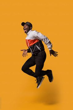 Stylish sporty man jumping over a yellow background by VICTOR TORRES - Studio, Black - Stocksy United Portrait Photography Men, Photography Poses For Men, Editorial Photography, Creative Photography, Jumping Poses, Ritter Sport, Pose Reference Photo, Men Photoshoot, Figure Poses