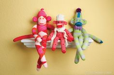 Store-bought socks are just too sweet when you turn them into a row of quirky sock monkeys! Use a standard sock monkey design and play with fashion-forward colors and patterns.