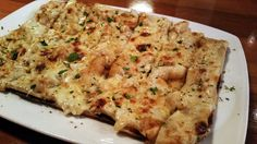 Seafood Flatbread: Flatbread with diced shrimp, scallops, and crab meat with Alfredo Old Bay cream sauce.
