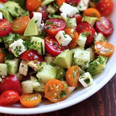 Tomato, Cucumber & Avocado Salad 1 1/2 C Cherry Tomatoes (halved) - 1 Cucumber (peeled, seeded, and diced) - 1 Avocado (diced) - 4 oz Feta Cheese (crumbled) - 2 T Red Onion (chopped) - 2 T Parsley (minced) - Olive Oil Drizzle