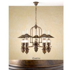 "Price: $1,435.50  Lustrarte 367/5M Five Light One Tier Chandelier from the Velha Collection - Lustrarte 367/5M Five Light One Tier Chandelier from the Velha Collection  Lustrarte 367/5M Features: Matte Lantern Shaped GlassSolid Brass Construction Lustrarte 367/5M Specifications: Number of Bulbs: 5Bulb Base: Candelabra / E12Bulb Shape: Type BWatts Per Bulb: 40Bulb Type: IncandescentBulbs Included: NoHeight: 24.8""Width: 31.5""UL Listed for Dry Location"