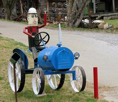 "Didn't know whether to put it in ""mailboxes"" or ""tractors."" Click through to see 49 more creative mailboxes."