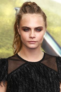 Delevingne adds a twist to the staid ponytail with corn-rowed braids extending back from the hairline. See 15 perfect braided hairstyles to try now: