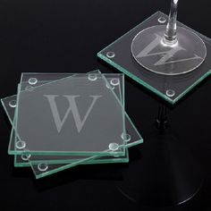 "Engraved Initial Glass Coasters Set. These modern & stylish Engraved Glass Coasters have a wonderful classic appeal. They make the perfect gift for treating others or yourself! Featuring clear protective pads attached to the bottom of each corner to guard surfaces from any damages. Perfect for any Wedding Gift Idea or just because. Sold in a set of four, these glass coasters measure 4"" x 4"" and are 3/16"" thick. Free Personalization is included! The Glass Coasters may be"
