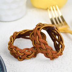 Make these simple leather braided napkin rings with a 6-strand braid to decorate your table for Thanksgiving and other occasions.