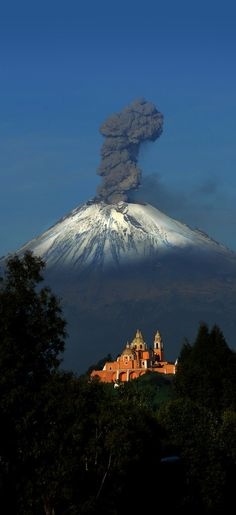 Cholula church and Popocatepetl volcano, in beautiful Puebla, Mexico. http://WhatIsTheBestMountainBike.com
