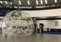 Soundhelmet Object Installation in front of NASA at Copuos 2019 at the UNO in Vienna Vienna, Nasa, Chandelier, Ceiling Lights, Lighting, Artwork, Home Decor, Candelabra, Work Of Art