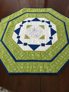 Quilted Table Topper Spring and Summer Table Runner Bee Decor Lime Green and Royal Blue Floral Octagon Quiltsy Handmade by homesewnbychristine on Etsy Quilted Table Toppers, Quilted Table Runners, Whimsical Christmas, Flower Center, Quilt Sets, Green Backgrounds, Decorating Your Home, Royal Blue, Lime