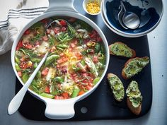 Quinoa cooks right in the soup without soaking up too much liquid. If you'd like to change to a heartier grain like farro or barley, cook...