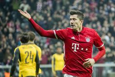 Robert Lewandowski Photos Photos - Robert Lewandowski of Bayern Munich celebrates after scoring his team's second goal during the UEFA Champions League Round of 16 first leg match between FC Bayern Muenchen and Arsenal FC at Allianz Arena on February 15, 2017 in Munich, Germany. - FC Bayern Muenchen v Arsenal FC - UEFA Champions League Round of 16: First Leg
