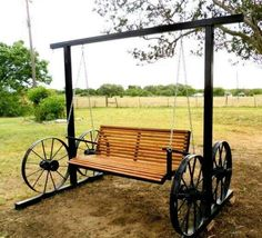 Wagon wheel bench swing