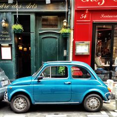 Turquoise Fiat 500 on the rue St.-Andre-des-Arts in Paris.  One of my favorite streets in Pais.