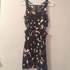 Galaxy themed Black mini dress Very comfortable and cute black short dress with pink and yellow design kind of looks like a galaxy theme. The sides are cut out and the back has a small zip near the top Material Girl Dresses Mini