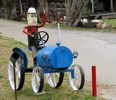 "Didn't know whether to put it in ""mailboxes"" or ""tractors."" Click through to see 49 more creative mailboxes. Office Mailboxes, Funny Mailboxes, Unique Mailboxes, Recycling, You've Got Mail, Post Box, Metal Art, Upcycle, Mailbox Ideas"